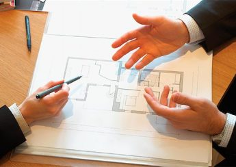 700-01259854 © Daniel Barillot Model Release: No Property Release: Yes Property Release Business People Talking over Blueprint